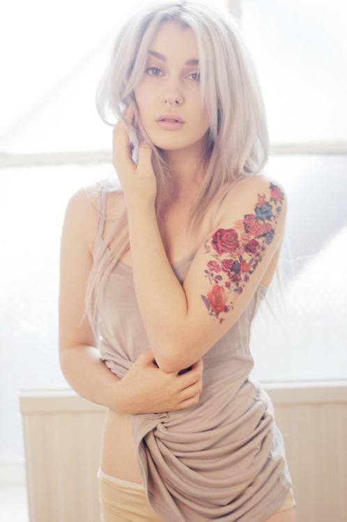 cute girl arm tattoo