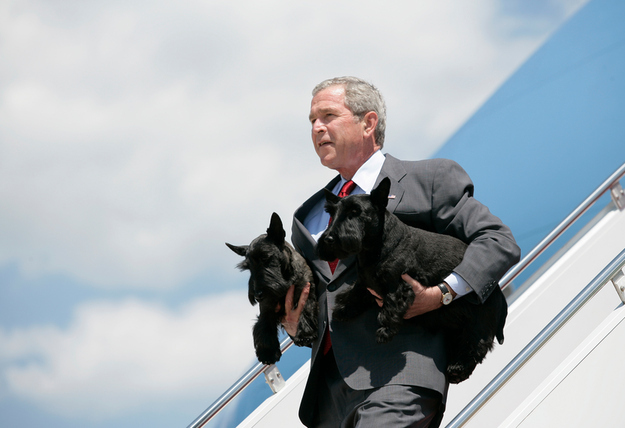 George W. Bush carrying Barney and Mrs. Beasley off Air Force One