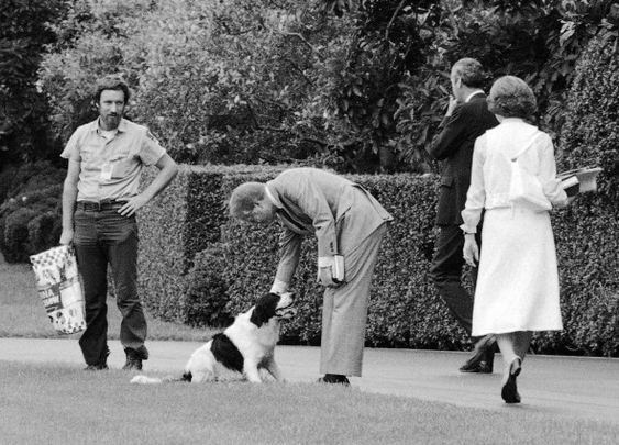 Jimmy Carter pets his daughter's dog Grits