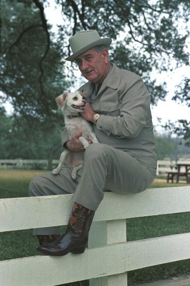 Lyndon Johnson with his dog at his ranch